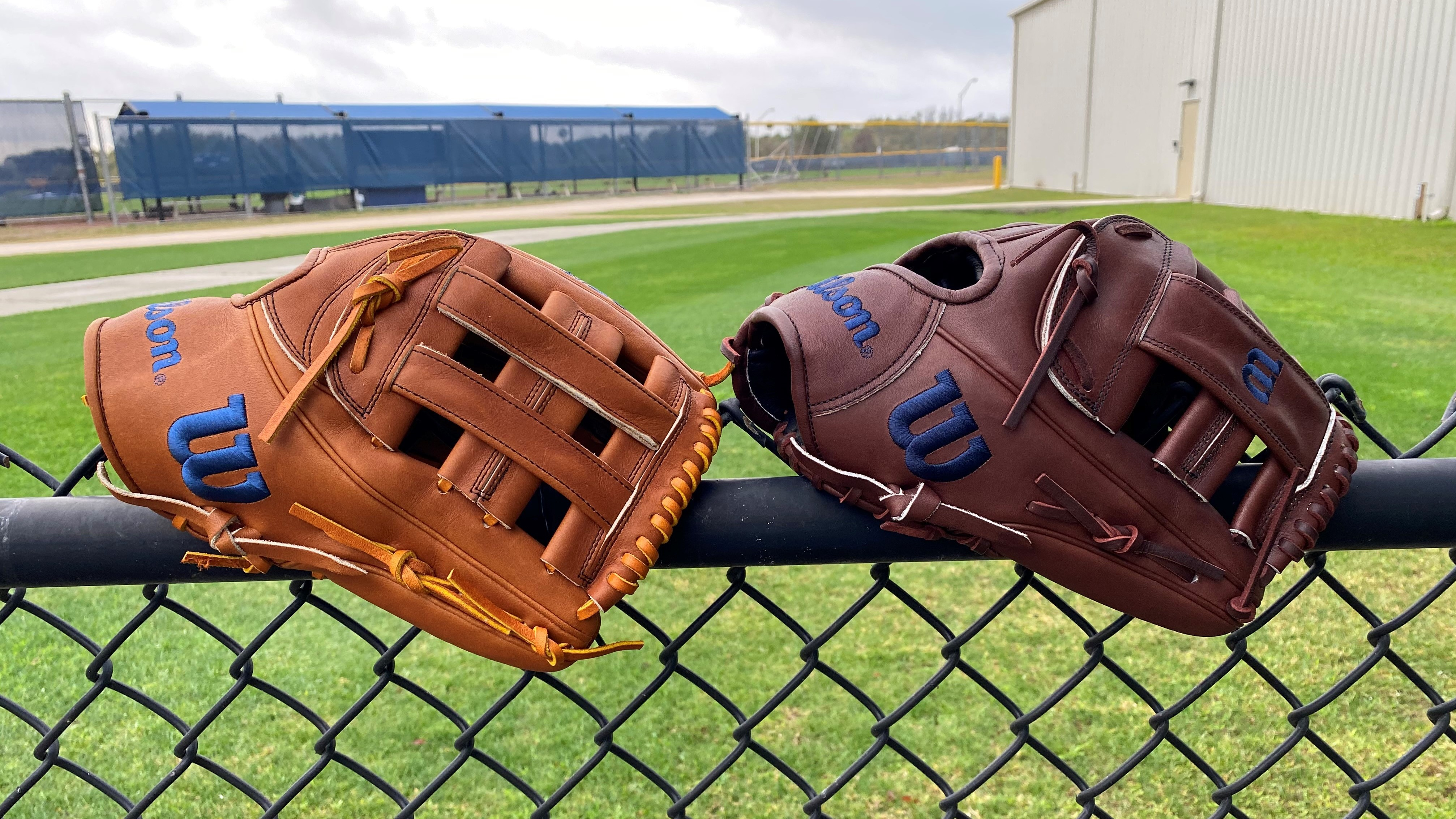 Joey Wendel's gloves on a fence