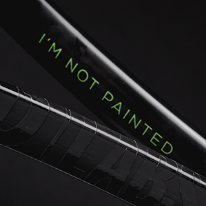"""closeup of racket that says """"I'm not painted."""""""