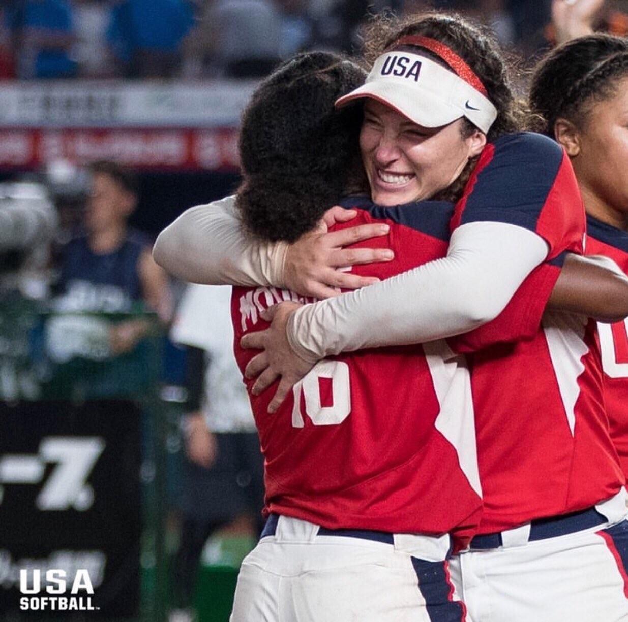Valarie Arioto and teammate hugging