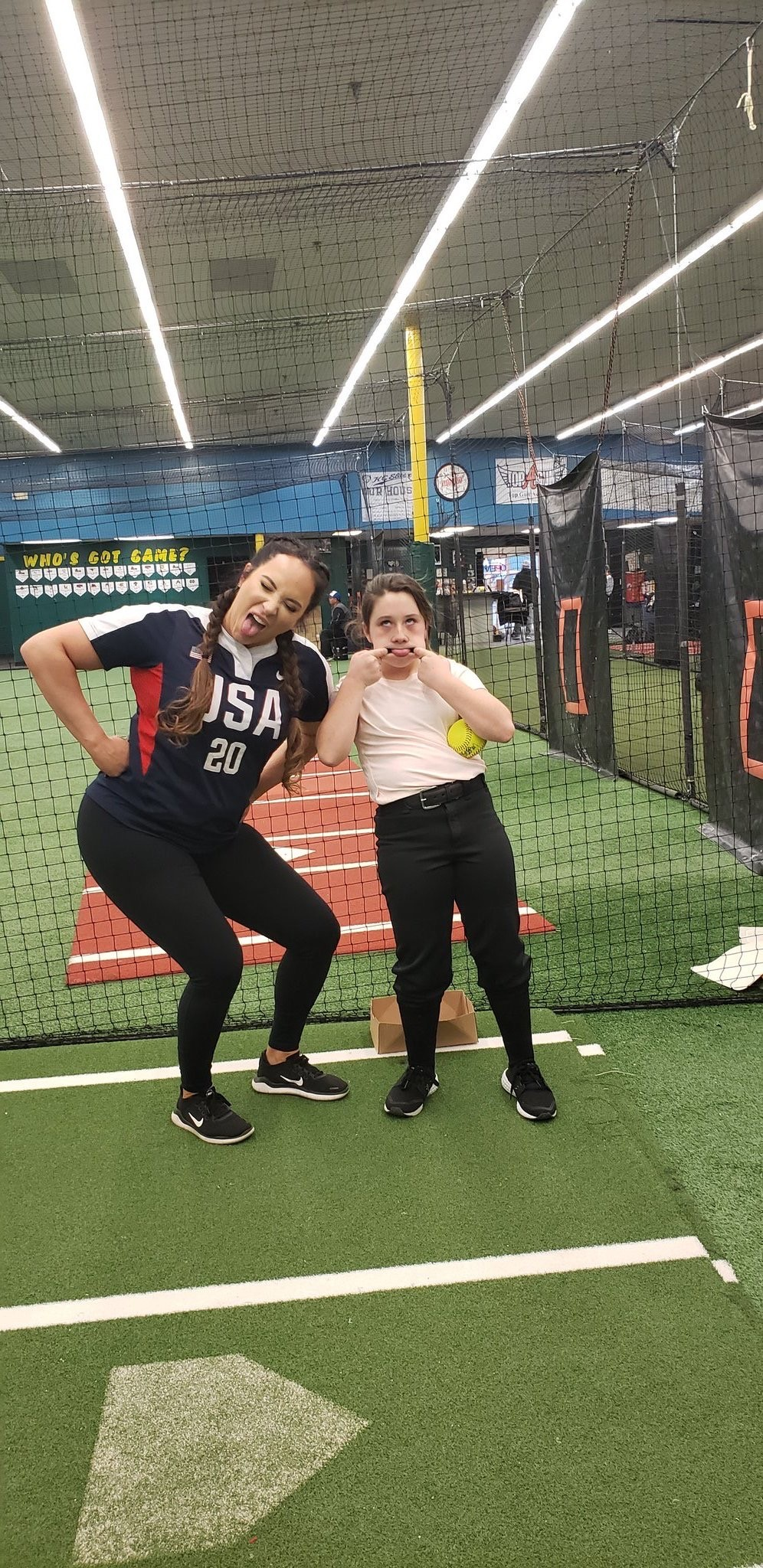 Valarie Arioto and young player joking around at a clinic
