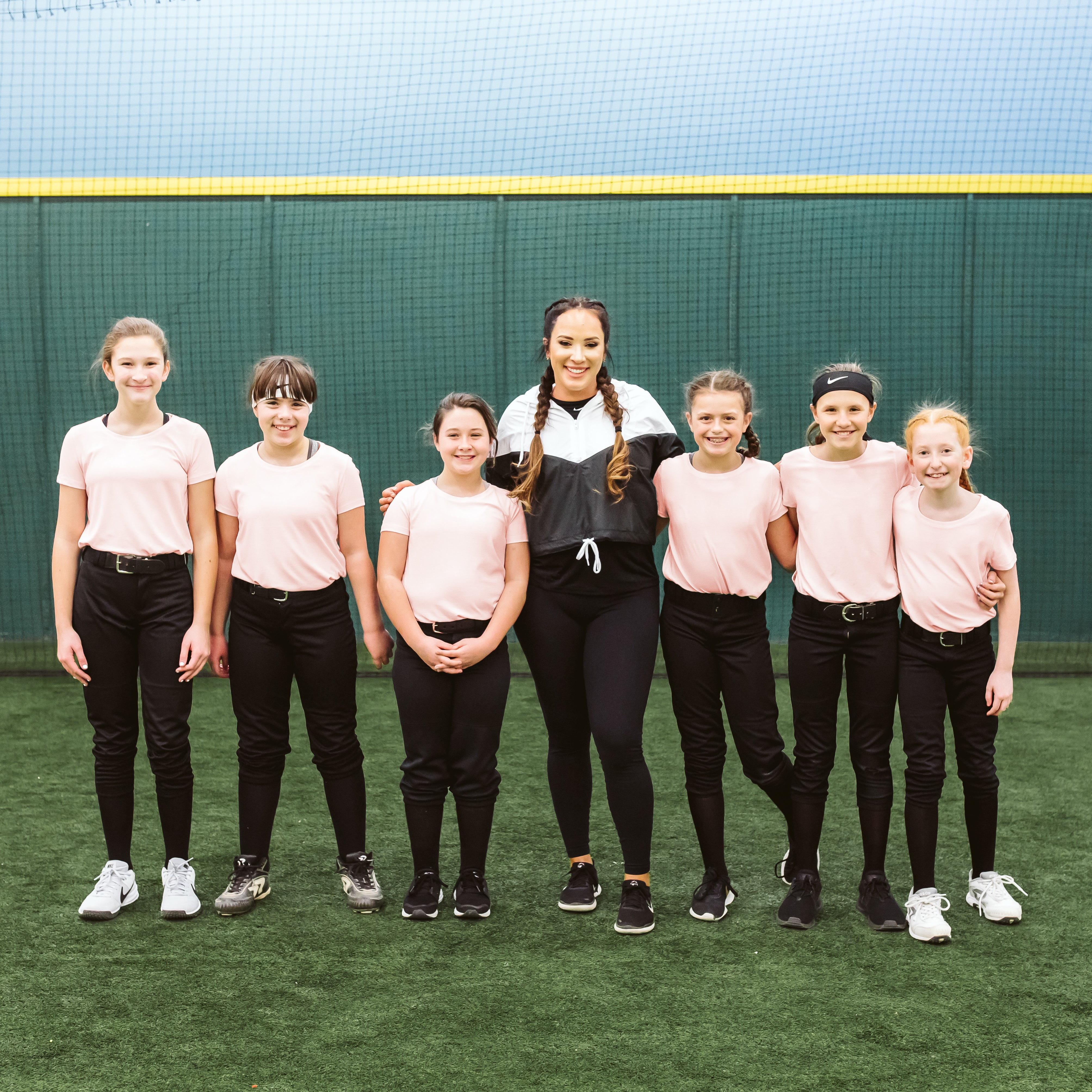 Valarie Arioto and young players at a clinic