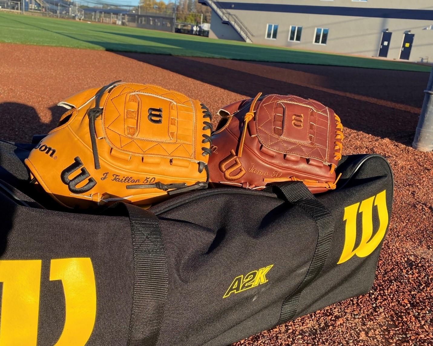 wilson game model ball gloves on a duffle bag