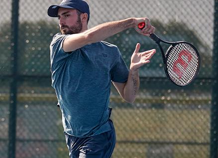 Man hitting a forehand tennis shot